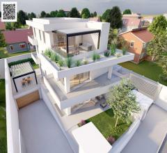 Appartamento in villa indipendente con giardino e taverna.
